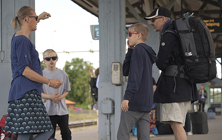 Swedish lawyer Pia Bjorstrand, her husband and their two sons await to board the first of many trains on a whistle-stop vacation around northern Europe in Nykoping, on Saturday, June 15, 2019. The family is part of a small but growing movement in Europe and North America that's shunning air travel because it produces high levels of greenhouse gas emissions. (AP Photo/David Keyton)