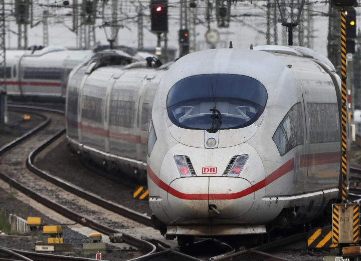 An ICE train approaches the main train station in Frankfurt, Germany, Wednesday, June 19, 2019. (AP Photo/Michael Sohn)