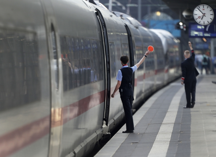 Conductors give the go for an ICE train the main train station in Frankfurt, Germany, Wednesday, June 19, 2019. (AP Photo/Michael Sohn)