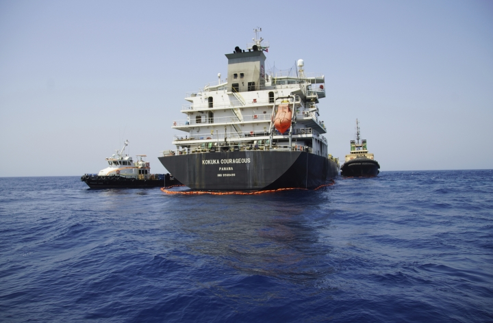 "The Panama-flagged, Japanese owned oil tanker Kokuka Courageous, that the U.S. Navy says was damaged by a limpet mine, is anchored off Fujairah, United Arab Emirates, during a trip organized by the Navy for journalists, Wednesday, June 19, 2019. The limpet mines used to attack the oil tanker near the Strait of Hormuz bore ""a striking resemblance"" to similar mines displayed by Iran, a U.S. Navy explosives expert said Wednesday. Iran has denied being involved. (AP Photo/Fay Abuelgasim)"