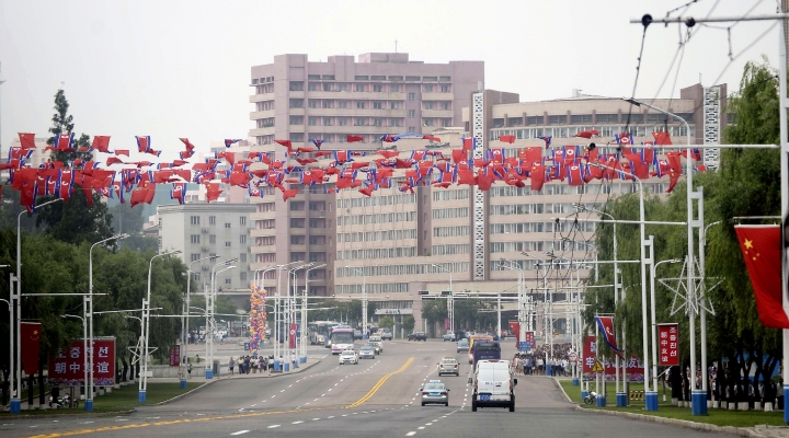 A street is decorated with flags of North Korea and China in central Pyongyang, North Korea, Thursday, June 20, 2019. The leaders of China and North Korea met in the North's capital on Thursday, their fifth meeting in 15 months, with stalled nuclear negotiations with Washington expected to be on the agenda.(Kyodo News via AP)