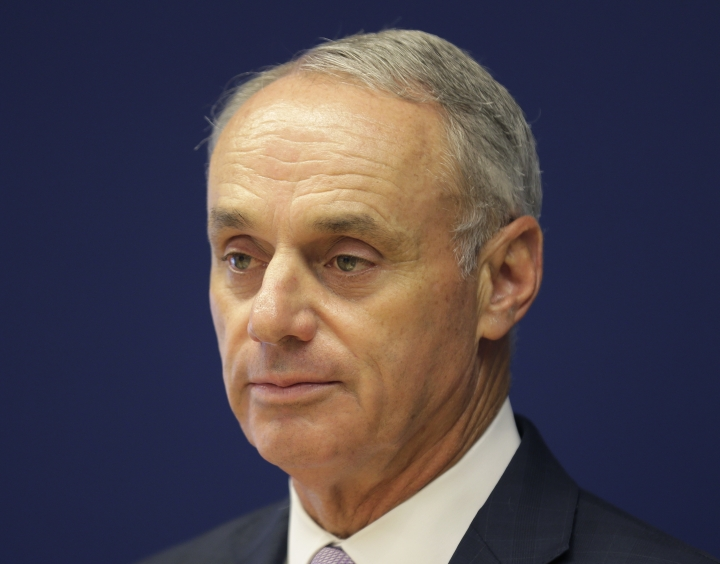 Major League Baseball commissioner Rob Manfred speaks to reporters after a meeting of baseball team owners in New York, Thursday, June 20, 2019. The Tampa Bay Rays have received permission from Major League Baseball's executive council to explore a plan that could see the team split its home games between the Tampa Bay area and Montreal, reports said Thursday. (AP Photo/Seth Wenig)