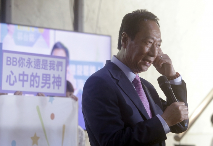Terry Gou, chairman of Foxconn, the world's largest contract assembler of consumer electronics, listens to a question from the media after the company's annual shareholders meeting in New Taipei City, Taiwan, Friday, June 21, 2019. Gou said he is stepping down amid speculation he could be planning a presidential run next year. (AP Photo/Chiang Ying-ying)