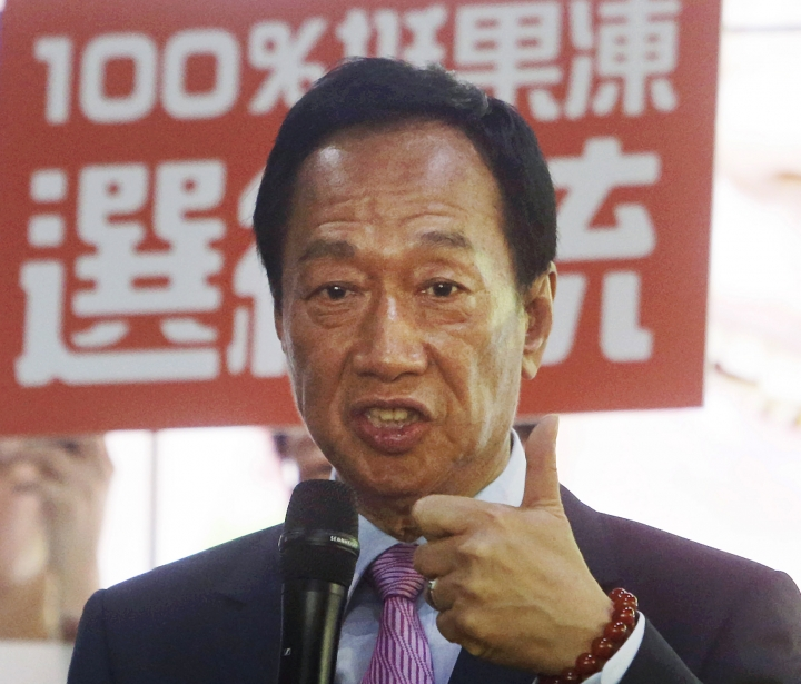 Terry Gou, chairman of Foxconn, the world's largest contract assembler of consumer electronics, speaks to the media after the company's annual shareholders meeting in New Taipei City, Taiwan, Friday, June 21, 2019. Gou said he is stepping down amid speculation he could be planning a presidential run next year. (AP Photo/Chiang Ying-ying)