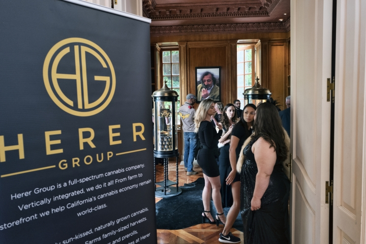 In this Thursday, June 20, 2019 photo representatives greet guests the Jack Herer cannabis company's lounge during the cannabis networking expo, WeedCon West 2019 in Los Angeles. Marijuana shoppers are going to be getting a message from California regulators: Go legal. Aiming to slow illegal pot sales that are undercutting the nation's largest licensed market, California is kicking off a public information campaign, Get #weedwise, that encourages consumers to verify that their purchases are tested and legal. (AP Photo/Richard Vogel)
