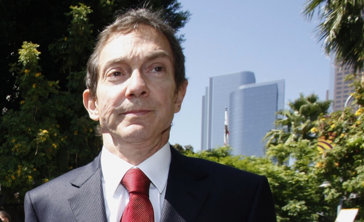 FILE - In this July 6, 2009 file photo, Lawyer John Branca, co-executor of Michael Jackson's estate, leaves the Superior court in Los Angeles. (AP Photo/Nick Ut, File)