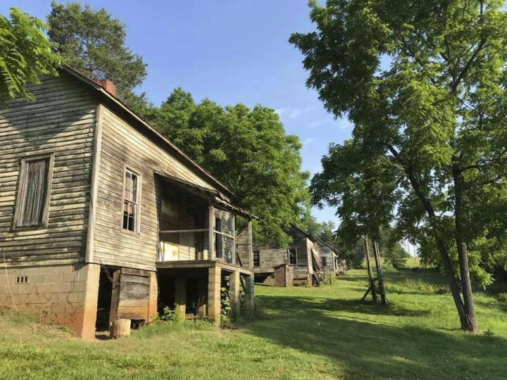"This undated photo made available by Calvin Reyes, shows buildings in an abandoned mill village near Asheville, NC., that was used in the first ""Hunger Games"" movie. The village is now a historic site. The designation for the Henry River Mill Village was announced earlier this week. (Calvin Reyes via AP)"