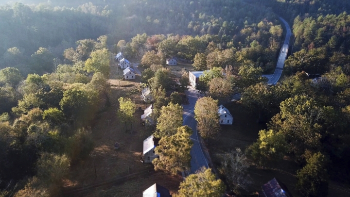 "In this undated photo made available by Clayton Joe Young, shows an aerial view of an abandoned mill village near Asheville, NC., that was used in the first ""Hunger Games"" movie/ The villages is now an historic site. The designation for the Henry River Mill Village was announced earlier this week. (Clayton Joe Young via AP)"