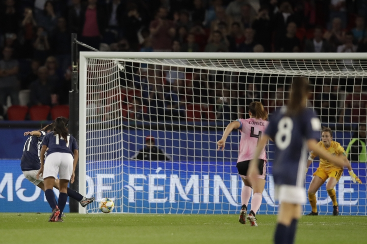 Argentina's Florencia Bonsegundo, left, shoots a penalty kick to score an equaliser goal during the Women's World Cup Group D soccer match between Scotland and Argentina at Parc des Princes in Paris, France, Wednesday, June 19, 2019. Bonsegundo scored in the extra time and the match ended in a 3-3 draw. (AP Photo/Alessandra Tarantino)