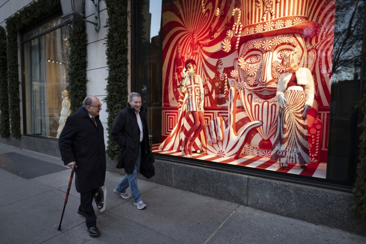 "FILE - This Dec. 5, 2018 file photo shows men walking past a holiday window at the Bergdorf Goodman store, in New York. E. Jean Carroll, a New York-based advice columnist claims Donald Trump sexually assaulted her in a dressing room at a Manhattan department store in the mid-1990s. The first-person account was published Friday, June 21, in New York magazine. Trump denied the allegations and said ""I've never met this person in my life."" (AP Photo/Mark Lennihan, File)"
