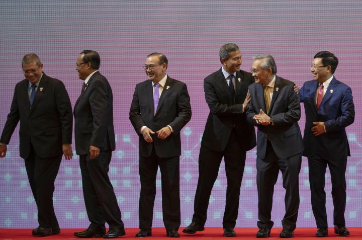 From left, Malaysia Foreign Minister Saifuddin Abdullah, Myanmar Minister of State for Foreign Affaires Kyaw Tin, Philippines Foreign Affaires Secretary Teodoro Locsin Jr., Singapore Foreign Minister Vivian Balakrishnan, Thailand Foreign Minister Don Pramudwinai and Vietnam Foreign Minister Pham Binh Minh, prepare to walk back to their seats after posing for a group photo during the Association of Southeast Asian Nations (ASEAN) Foreign Ministers' meeting in Bangkok, Thailand, Saturday, June 22, 2019. (AP Photo/Gemunu Amarasinghe)