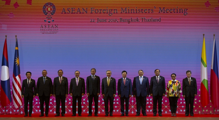 Foreign ministers of the Association of Southeast Asian Nations (ASEAN) from left, Laos Foreign Minister Saleumxay Kommasith, Malaysia Foreign Minister Saifuddin Abdullah, Myanmar Minister of State for Foreign Affaires Kyaw Tin, Philippines Foreign Affaires Secretary Teodoro Locsin Jr., Singapore Foreign Minister Vivian Balakrishnan, Thailand Foreign Minister Don Pramudwinai, Vietnam Deputy Prime Minister and Foreign Minister Pham Binh Minh, Brunei Second Minister of Foreign affaires and Trade Erywan Yusof, Cambodia Foreign Minister Prak Sokhonn, Indonesia Foreign Minister Retno Marsudi and ASEAN Secretary-General Dato Lim Jock Hoi pose for a group photo during the ASEAN Foreign Ministers' meeting in Bangkok, Thailand, Saturday, June 22, 2019. (AP Photo/Gemunu Amarasinghe)