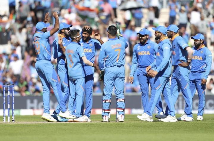 India's Jasprit Bumrah, fourth left, celebrates with teammates the dismissal of Afghanistan's Hashmatullah Shahidi during the Cricket World Cup match between India and Afghanistan at the Hampshire Bowl in Southampton, England, Saturday, June 22, 2019. (AP Photo/Aijaz Rahi)