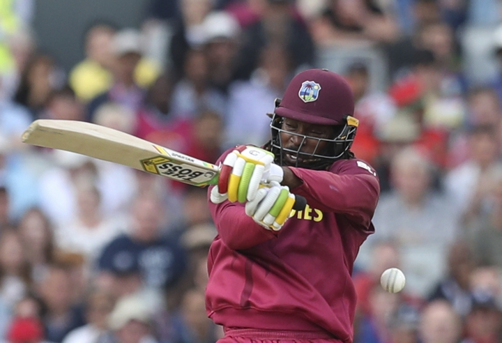 West Indies' Chris Gayle bats during the Cricket World Cup match between New Zealand and West Indies at Old Trafford in Manchester, England, Saturday, June 22, 2019. (AP Photo/Jon Super)