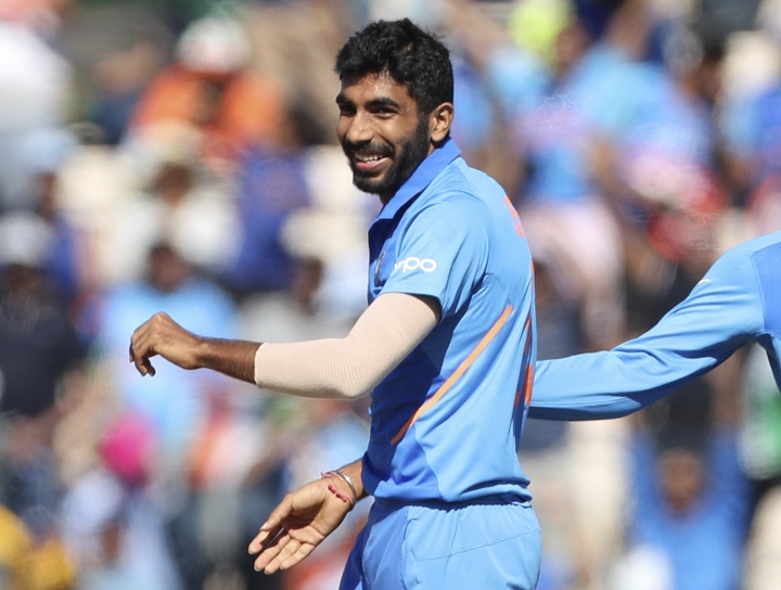 India's Jasprit Bumrah celebrates the dismissal of Afghanistan's Hashmatullah Shahidi during the Cricket World Cup match between India and Afghanistan at the Hampshire Bowl in Southampton, England, Saturday, June 22, 2019. (AP Photo/Aijaz Rahi)