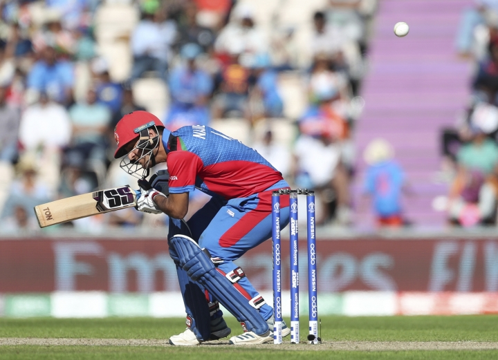 Afghanistan's Najibullah Zadran evades a rising delivery during the Cricket World Cup match between India and Afghanistan at the Hampshire Bowl in Southampton, England, Saturday, June 22, 2019. (AP Photo/Aijaz Rahi)