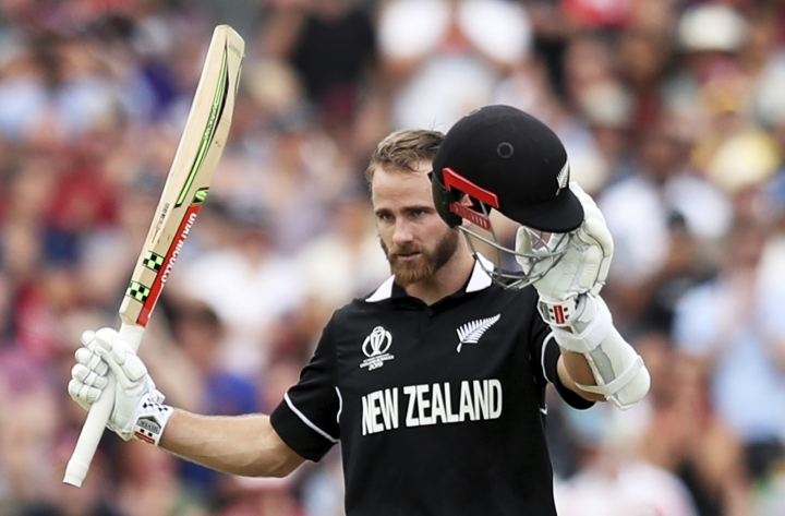 New Zealand's captain Kane Williamson celebrates after scoring a century during the Cricket World Cup match between New Zealand and West Indies at Old Trafford in Manchester, England, Saturday, June 22, 2019. (AP Photo/Jon Super)
