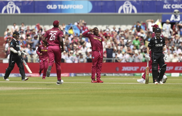 West Indies' Sheldon Cottrell celebrates after dismissing New Zealand's Colin Munro during the Cricket World Cup match between New Zealand and West Indies at Old Trafford in Manchester, England, Saturday, June 22, 2019. (AP Photo/Jon Super)