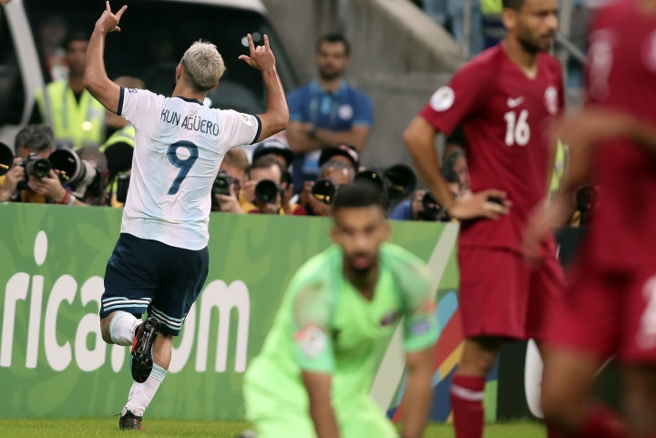 Argentina's Sergio Aguero, left, celebrates after scoring his side's 2nd goal during a Copa America Group B soccer match against Qatar at the Arena do Gremio in Porto Alegre, Brazil, Sunday, June 23, 2019. (AP Photo/Edison Vara)