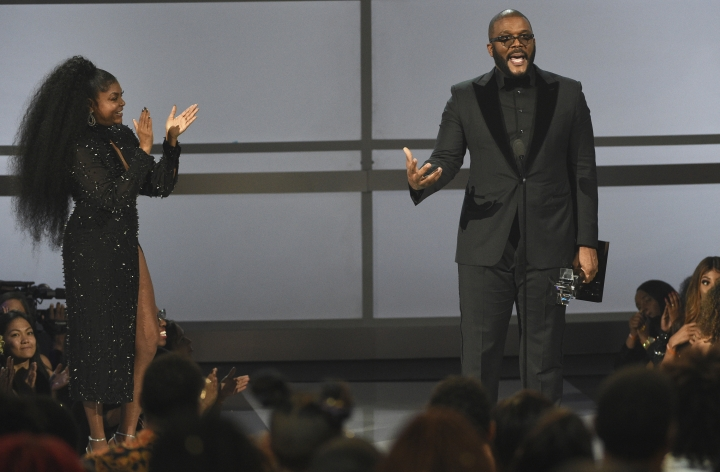 Tyler Perry accepts the ultimate icon award at the BET Awards on Sunday, June 23, 2019, at the Microsoft Theater in Los Angeles. Looking on at left is presenter Taraji P. Henson. (Photo by Chris Pizzello/Invision/AP)