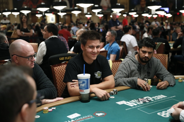 """""""Jeopardy!"""" champion and professional sports gambler James Holzhauer, center, plays in a tournament at the World Series of Poker, Monday, June 24, 2019, in Las Vegas. (AP Photo/John Locher)"""