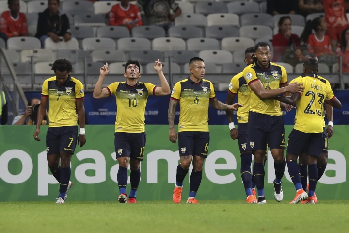 Ecuador's Angel Mena, second left, celebrates after scoring his side's first goal against Japan during a Copa America Group C soccer match at the Mineirao stadium in Belo Horizonte, Brazil, Monday, June 24, 2019. (AP Photo/Ricardo Mazalan)