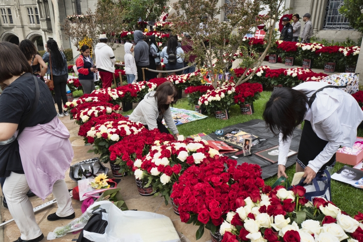 Michael Jackson fans line up and leave flowers and artwork along with personal notes paying their respect during at the singers mausoleum for the 10th Anniversary of Jackson's death in front of the singers mausoleum at Forest Lawn Cemetery In Glendale, Calif. on Tuesday, June 25, 2019. Fans of Michael Jackson are gathering to pay tribute to the King of Pop on the 10th anniversary of his death. Jackson's family and friends and are also likely to take to social media to share their memories and acknowledge the moment on Tuesday's anniversary. (AP Photo/Richard Vogel)