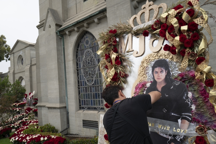 Florist Takeshi Nakamura puts together an arrangement requested by a client from Japan for the 10th Anniversary of Michael Jackson's death outside Jackson's mausoleum at Forest Lawn Cemetery In Glendale, Calif. on Tuesday, June 25, 2019. (AP Photo/Richard Vogel)
