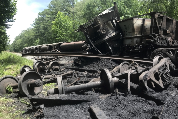 This image provided by the U.S. Fish and Wildlife Service shows coal trains that derailed in the Great Dismal Swamp national Wildlife Refuge in Chesapeake, Va., Wednesday June, 26, 2019. (Chris Lowie/US Fish and Wildlife Service)