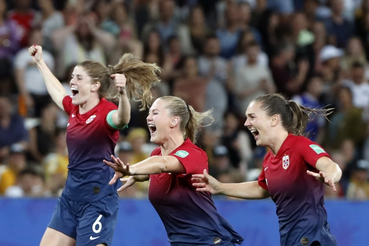 Norway's Maren Mjelde, left, Lisa-Marie Utland, center, and Vilde Boe Risa celebrate after winning the penalty shoot-out of the Women's World Cup round of 16 soccer match between Norway and Australia at the Stade de Nice in Nice, France, Saturday, June 22, 2019. (AP Photo/Thibault Camus)