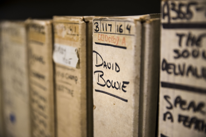 "In this May 8, 2019 photo show is a reel from David Bowie's recording sessions at the Sigma Sound Studio while getting together his 1974 ""Young Americans"" album, at Drexel University in Philadelphia. A college music department has helped resurrect the music of a largely forgotten Philadelphia funk band and is hoping to discover more gems in its archives. Going through thousands of donated tapes, a band called the Nat Turner Rebellion jumped out to listeners at Drexel University. They assembled ""Laugh to Keep From Crying,"" the band's debut album. It was recently released some 50 years after it was recorded at Sigma Sound, the studio which helped create the so-called ""Sound of Philadelphia."" (AP Photo/Matt Rourke)"