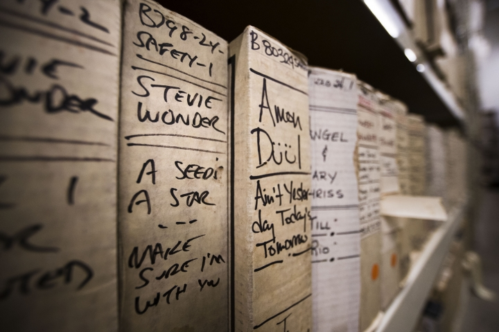 """In this May 8, 2019 photo shown is a reel from Stevie Wonder's recording sessions at the Sigma Sound Studio, at Drexel University in Philadelphia. A college music department has helped resurrect the music of a largely forgotten Philadelphia funk band and is hoping to discover more gems in its archives. Going through thousands of donated tapes, a band called the Nat Turner Rebellion jumped out to listeners at Drexel University. They assembled """"Laugh to Keep From Crying,"""" the band's debut album. It was recently released some 50 years after it was recorded at Sigma Sound, the studio which helped create the so-called """"Sound of Philadelphia."""" (AP Photo/Matt Rourke)"""