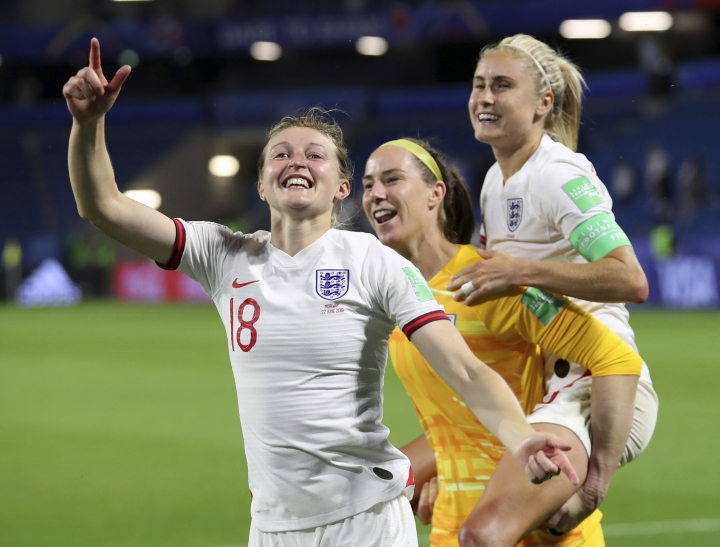 England's Ellen White, left, celebrates with teammates Karen Bardsley, center, and Steph Houghton, right, during the Women's World Cup quarterfinal soccer match between Norway and England at the Oceane stadium in Le Havre, France, Thursday, June 27, 2019. (AP Photo/Francisco Seco)