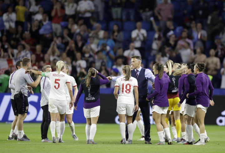 England head coach Philip Neville celebrates with his players following their 3-0 win over Norway in their Women's World Cup quarterfinal soccer match at Oceane Stadium in Le Havre, France, Thursday, June 27, 2019. (AP Photo/Alessandra Tarantino)