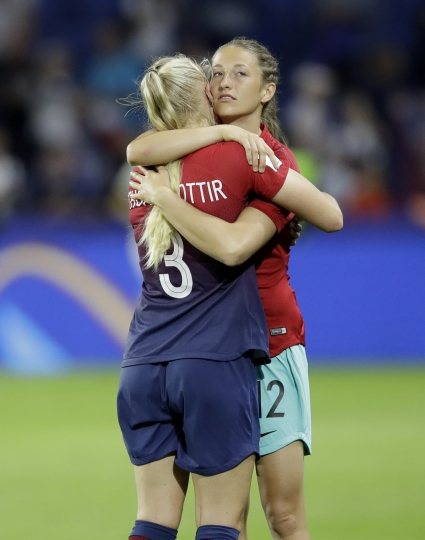 Norway's Maria Thorisdottir, left, and goalkeeper Cecilie Fiskerstrand embrace following their 3-0 loss to England in their Women's World Cup quarterfinal soccer match at Oceane Stadium in Le Havre, France, Thursday, June 27, 2019. (AP Photo/Alessandra Tarantino)