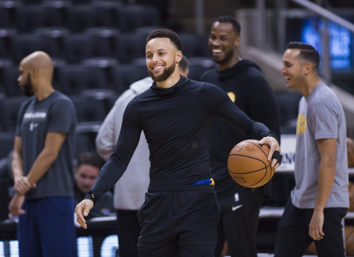 FILE - In this May 29, 2019 file photo, Golden State Warriors guard Stephen Curry smiles during practice for the NBA Finals against the Toronto Raptors in Toronto. The Golden State Warriors superstar is strategically producing content that focuses on sports, family and faith through Unanimous Media, which he co-founded with Jeron Smith and Erick Peyton. The newly-formed production company already has several projects under its belt including a major studio film, network television show and a couple documentaries in just a year. (Nathan Denette/The Canadian Press via AP, File)