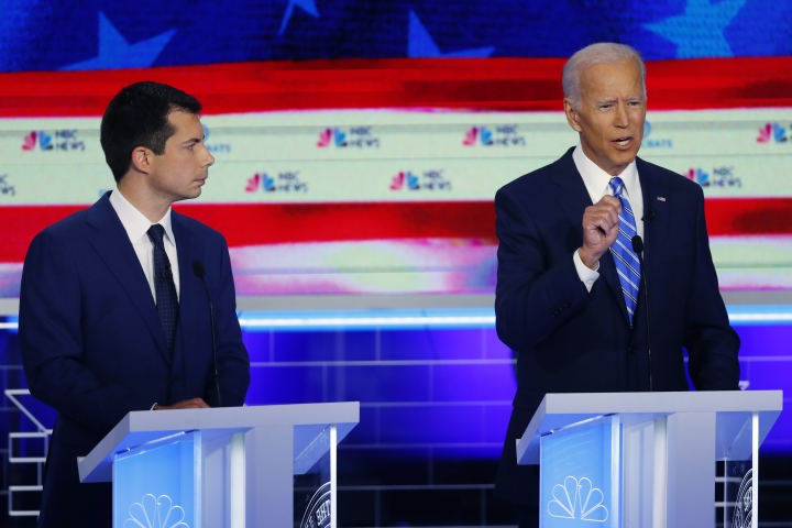 Democratic presidential candidate former vice president Joe Biden, right, speaks during the Democratic primary debate hosted by NBC News at the Adrienne Arsht Center for the Performing Arts, Thursday, June 27, 2019, in Miami, as South Bend Mayor Pete Buttigieg listens. (AP Photo/Wilfredo Lee)