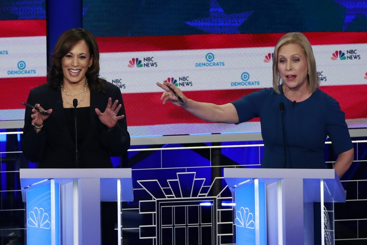 Democratic presidential candidate Sen. Kristen Gillibrand, D-N.Y., right, and Sen. Kamala Harris, D-Calif., gesture during the Democratic primary debate hosted by NBC News at the Adrienne Arsht Center for the Performing Arts, Thursday, June 27, 2019, in Miami. (AP Photo/Wilfredo Lee)