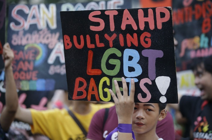 A member of the LGBTQ community holds a banner during a Pride march outside the Presidential palace in Manila, Philippines on Friday, June 28, 2019 to commemorate the 50th anniversary of the Stonewall riots in New York. The group is also marking the 25th year since the first Pride march in the country as they continue to call for gender equality and same-sex marriage.(AP Photo/Aaron Favila)