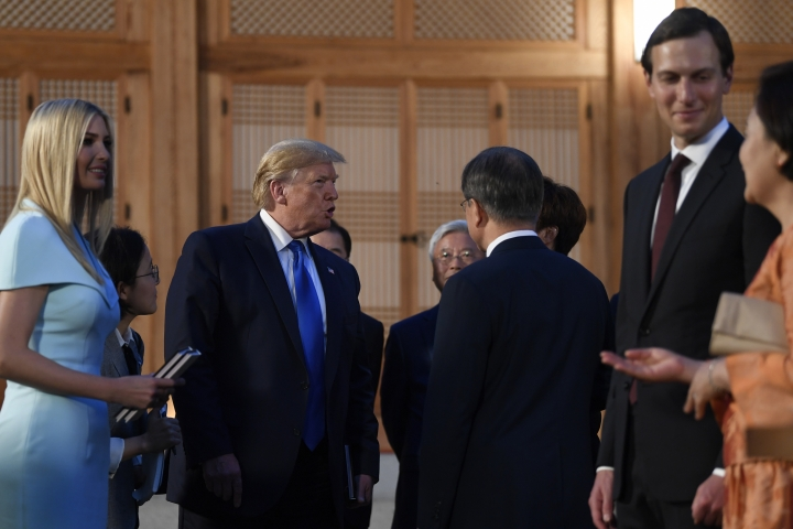 President Donald Trump, second from left, talks with South Korean President Moon Jae-in and other guests during a visit with South Korean President Moon Jae-in at the tea house on the grounds of the Blue House in Seoul, South Korea, Saturday, June 29, 2019. Trump is making a quick trip to Seoul after attending the G-20 summit in Osaka, Japan. Ivanka Trump, left, and Jared Kushner, second from right, attend. (AP Photo/Susan Walsh)