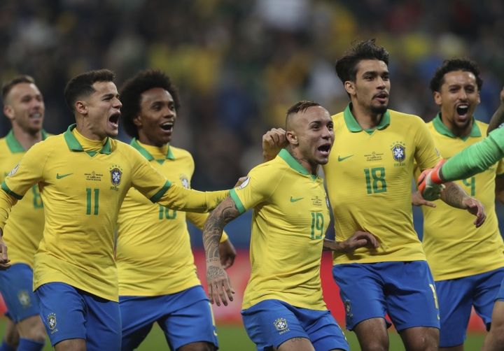 Brazil's players celebrate after winning the penalty shoot-out against Paraguay during a Copa America quarterfinal soccer match at the Arena do Gremio in Porto Alegre, Brazil, Thursday, June 27, 2019. (AP Photo/Natacha Pisarenko)