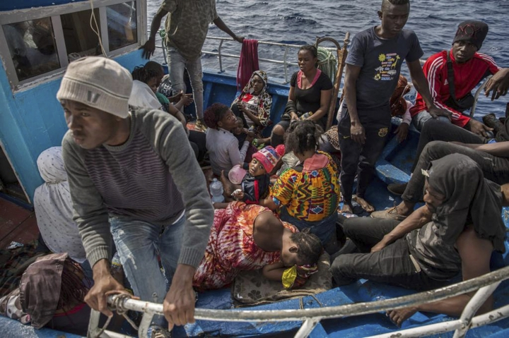 Migrants rest after being rescued at sea by the Open Arms aid boat on Sunday June 30, 2019. A humanitarian rescue group says it had spotted 40 severely dehydrated migrants in the Mediterranean and is escorting them toward Italy. Open Arms, a vessel run by a Spain-based charity, tweeted Sunday afternoon that the migrant boat had been at sea for three days and that passengers included three pregnant women and four children. (AP Photo/Olmo Calvo)