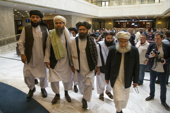 """FILE In this file photo taken on Tuesday, May 28, 2019, Mullah Abdul Ghani Baradar, the Taliban group's top political leader, third from left, arrives with other members of the Taliban delegation for talks in Moscow, Russia. The seventh and latest round of peace talks between the U.S. and Taliban is """"critical,"""" said Taliban spokesman Suhail Shaheen on Sunday June 30, 2019, the second day of talks with Washington's peace envoy Zalmay Khalilzad in the Mideastern state of Qatar, where the militant group maintains a political office. (AP Photo/Alexander Zemlianichenko, File)"""