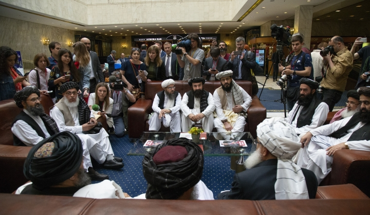 """FILE - In this file photo taken on Tuesday, May 28, 2019, Mullah Abdul Ghani Baradar, the Taliban group's top political leader, left, Sher Mohammad Abbas Stanikzai, the Taliban's chief negotiator, second left, and other members of the Taliban delegation speak to reporters prior to their talks in Moscow, Russia. The seventh and latest round of peace talks between the U.S. and Taliban is """"critical,"""" said Taliban spokesman Suhail Shaheen on Sunday June 30, 2019, the second day of talks with Washington's peace envoy Zalmay Khalilzad in the Mideastern state of Qatar, where the militant group maintains a political office. (AP Photo/Alexander Zemlianichenko, File)"""