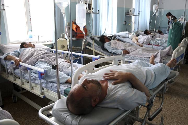 Wounded men receive treatment in a hospital after a bomb blast in Kabul, Afghanistan, Monday, July 1, 2019. A powerful bomb blast rocked the Afghan capital early Monday, rattling windows, sending smoke billowing from Kabul's downtown area and wounding dozens of people. (AP Photo/Rahmat Gul)