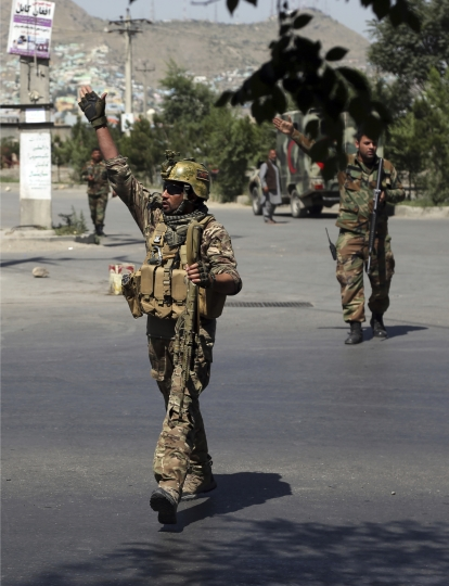 Afghan security forces arrive at the site of an explosion in Kabul, Afghanistan, Monday, July 1, 2019. A powerful bomb blast rocked the Afghan capital early Monday, rattling windows, sending smoke billowing from Kabul's downtown area and wounding dozens of people. (AP Photo/Rahmat Gul)