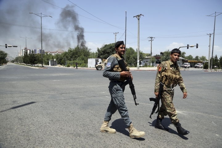 Security forces soldiers arrive at the site of an explosion in Kabul, Afghanistan, Monday, July 1, 2019. A powerful bomb blast rocked the Afghan capital early Monday, rattling windows, sending smoke billowing from Kabul's downtown area and wounding dozens of people, including nine children hurt by flying glass, officials and a medic said. (AP Photo/Rahmat Gul)