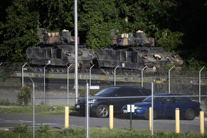 Bradley Fighting Vehicles sit on a flat car in a rail yard, Monday, July 1, 2019, in Washington, ahead of a Fourth of July celebration that President Donald Trump says will include military hardware. (AP Photo/Patrick Semansky)
