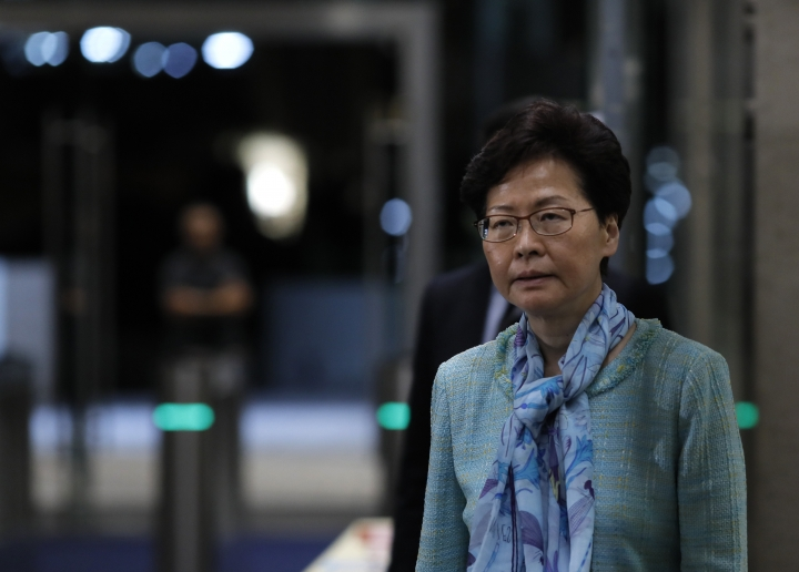 Hong Kong Chief Executive Carrie Lam listens to reporters questions during a press conference in Hong Kong, Tuesday, July 2, 2019, after hundreds of protesters in Hong Kong swarmed into the legislature's main building Monday night on the anniversary of Hong Kong's return to China. Lam condemned protesters who broke into the city's legislature and vandalized the building. (AP Photo/Vincent Yu)