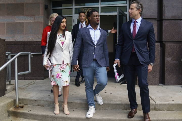 Philadelphia Phillies baseball player Odubel Herrera, center, leaves court with an unidentified friend after a hearing on a domestic violence case in Atlantic City, N.J., Wednesday, July 3, 2019. (Jessica Griffin/The Philadelphia Inquirer via AP, Pool)